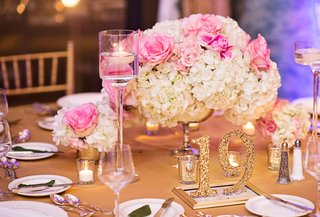 glittery-gold-table-numbers-with-pink-rose-and-white-hydrangea-centerpieces-floating-candles