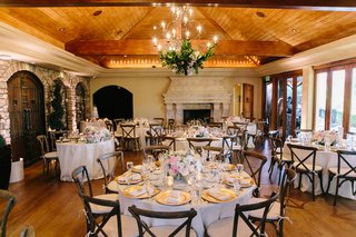 intimate-reception-space-with-wooden-chairs-floor-ceiling