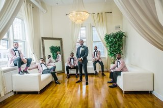 groom-in-tuxedo-groomsmen-with-dusty-pink-tuxedo-jackets