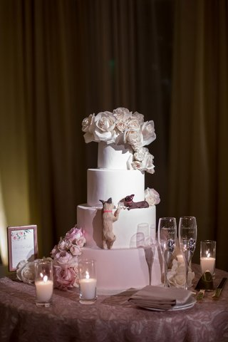 wedding-cake-with-white-blush-layers-fresh-flowers-and-dog-replica-eating-cake