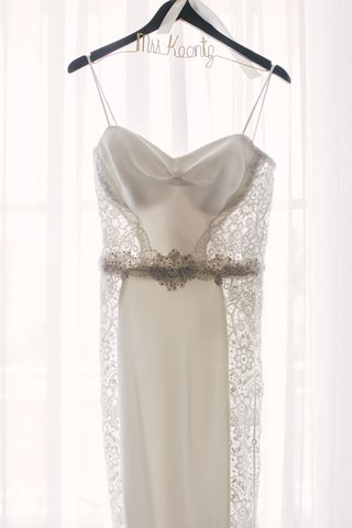 galia-lahav-wedding-dress-with-spaghetti-straps-lace-panels-beaded-belt-on-personalized-hanger