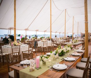 tented-reception-long-table-with-green-table-runner-light-pink-candles-wedding