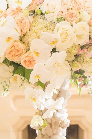 wedding-reception-centerpiece-of-white-orchids-hydrangeas-tulips-roses-peach-garden-roses