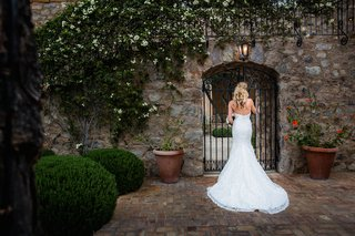 brock-osweilers-bride-erin-costales-in-demetrios-wedding-dress