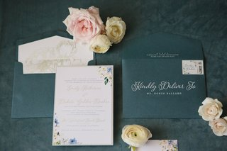 wedding-invitation-with-flower-motif-gold-details-white-calligraphy-blue-stationery-envelope