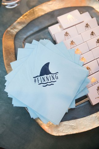 wedding-hashtage-napkin-light-blue-with-matches-finning-with-shark-dolphin-fin-motif-design