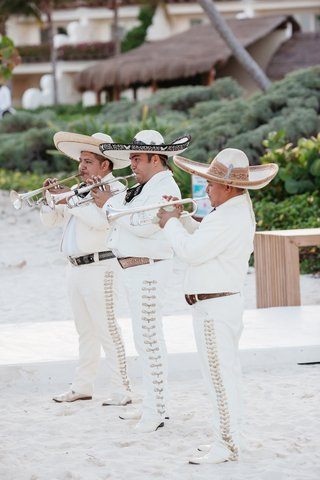 mariachi-band-in-white-outfits-at-a-beach-wedding-in-playa-del-carmen-mexico