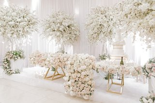 lush-florals-covering-gold-sweetheart-table-full-trees-of-florals