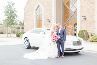 bride-and-groom-in-front-of-bentley-getaway-car-church-ceremony-to-reception-transportation
