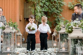 two-ring-bearers-walking-down-the-aisle-ring-bearer-moss-pillow-ring-bearer-outfits-ideas