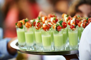 green-soup-in-shot-glass-with-tomato-and-mozzarella-skewer