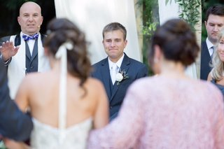 grooms-holds-back-tears-as-the-bride-walks-down-the-aisle