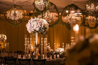 wedding-reception-tall-centerpiece-white-pink-flowers-gold-stand-candleholders-chandelier-orb