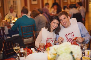 bride-and-groom-with-lobster-bibs-at-rehearsal-dinner