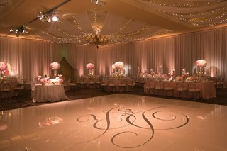 silver-wedding-monogram-on-large-white-dance-floor-at-wedding