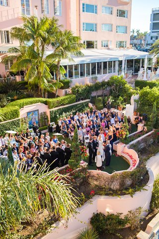 seaside-ceremony-saying-vows-guests-family-southern-california-wedding-la-valencia-hotel-la-jolla