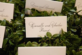escort-cards-on-green-leaves-with-black-hand-lettering