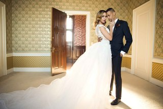 bride-goom-embracing-ball-gown-suit-ines-di-santo-michael-kors-classic-vintage-looks-styled-shoot