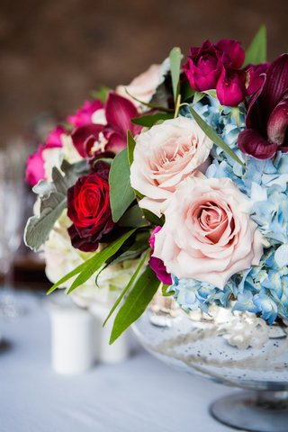 mercury-glass-centerpiece-with-pink-rose-blue-hydrangea-orchid