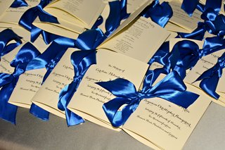 white-and-ivory-ceremony-program-tied-with-royal-blue-satin-ribbon