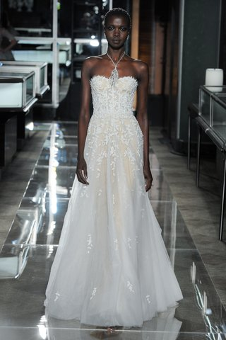 an-embroidered-strapless-tulle-gown-by-reem-acra