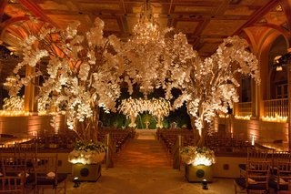 the-plaza-hotel-white-flowers-trees-in-ballroom-ceremony-space-with-chuppah-canopy-orchids