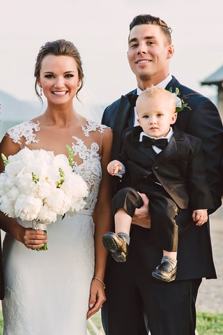 wedding-portrait-bride-in-illusion-wedding-dress-white-peony-bouquet-groom-with-tuxedo-and-son