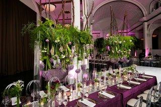vibiana-wedding-reception-purple-linens-clear-acrylic-chairs-greenery-orbs-candles