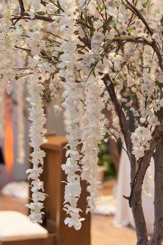 wedding-ceremony-with-cherry-blossom-tree-decorations-and-garlands-of-white-orchids