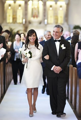 mother-of-groom-wearing-ivory-short-dress-with-silver-high-heels-and-father-of-groom-in-tuxedo