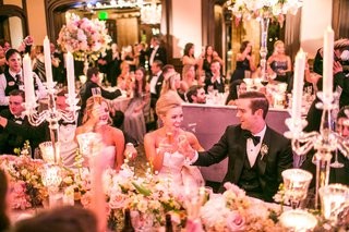 guests-toast-champagne-during-reception-with-candelabra-on-table