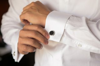black-circular-cufflinks-for-groom-at-wedding-with-silver-border