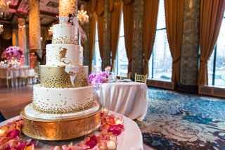 four-tiered-gold-wedding-cake-hearts-at-hometown-cake-topper-with-groom-dipping-bride