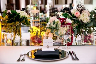 wedding-reception-table-with-mirror-runner-orchids-and-floating-candles-white-pink-burgundy-flowers