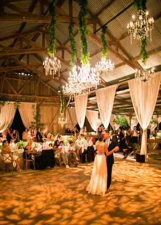 bride-in-keyhole-back-jenny-packham-wedding-dress-first-dance-in-barn-venue-high-ceilings-wood-beams
