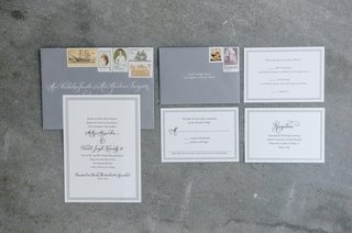 gray-envelopes-with-white-invitations