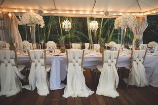 wedding-reception-in-maui-hawaii-jungle-white-linens-draped-from-chairs-pineapple-decor-white-flower
