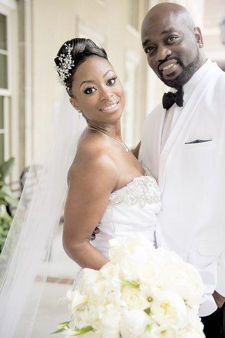 bride-in-strapless-jasmine-bridal-wedding-dress-and-groom-in-white-tux