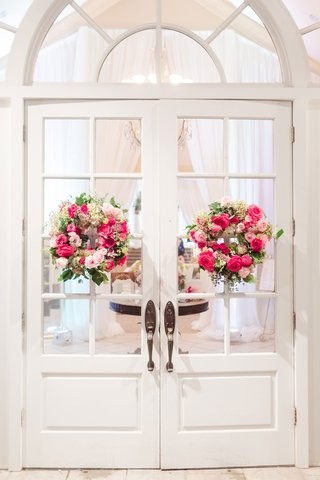 wedding-reception-entrance-white-doors-with-pink-rose-wreaths-greenery-flowers