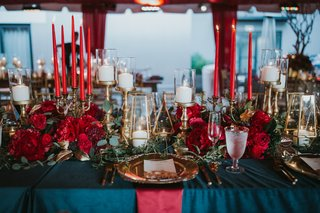 wedding-reception-navy-linens-red-tapered-candles-scarlet-peonies