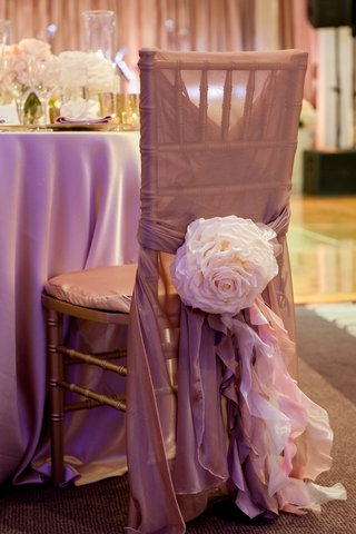 gold-chair-wrapped-with-champagne-sash-and-flower