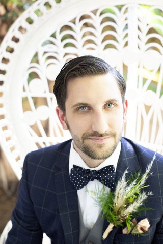 large-boutonniere-with-fern-and-pampas-grass-navy-windowpane-suit-polka-dot-tie