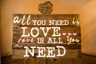 wedding-shower-sign-made-of-wooden-boards-with-quote-all-you-need-is-love-love-is-all-you-need
