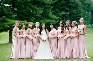 bride-in-high-neck-vera-wang-wedding-dress-with-bridesmaids-in-mismatched-pink-dresses