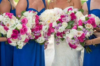 bridesmaid-bouquets-with-lavender-freesia-and-roses-fuschia-ivory-and-white-roses