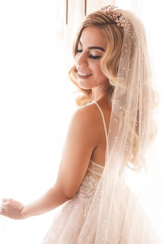 bridal-portrait-wedding-dress-spaghetti-strap-side-part-curled-hair-headpiece-rhinestone-veil