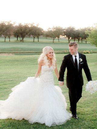 bride-in-eve-of-milady-wedding-dress-trumpet-gown-groom-in-black-suit-blonde-hair-dallas-wedding