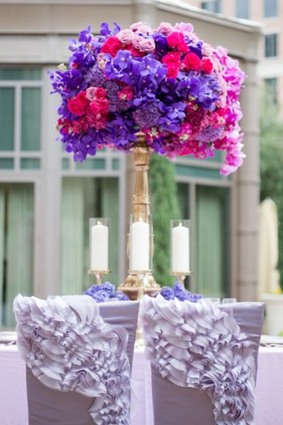 wedding-reception-chairs-with-light-purple-ruffled-chair-sleeves