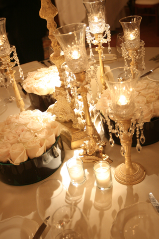 wedding-reception-table-with-crystal-candleholders-and-white-roses