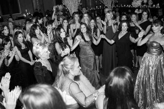 black-and-white-photo-of-wedding-guests-dancing